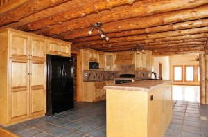 Spacious Kitchen With Beautiful Log Cabin Ceiling at 1170 Ramsey Memorial Road in Penhook, VA 24137