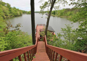 Gorgeous Lake Views And Convenient Access With This Bock Dock and Deck